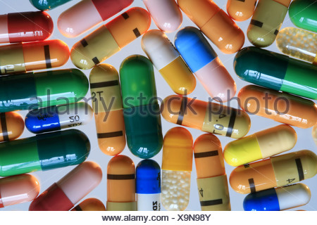 Different colourful pill capsules - Stock Photo