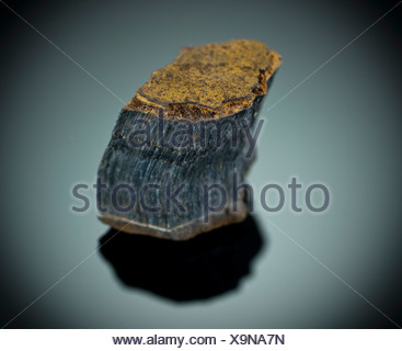 Cutout of a Blue Tiger's Eye or Hawk's Eye gemstone on black background - Stock Photo