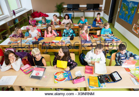 Children sitting in an elementary school class during a lesson, Reith im Alpbachtal, Kufstein district, Tyrol, Austria - Stock Photo