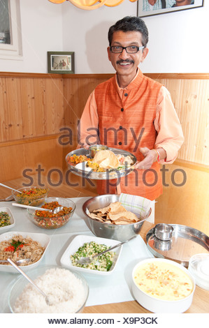 Ayurvedic chef Nicki Sabnis presenting Indian dishes, Frauenchiemsee or Fraueninsel in Lake Chiemsee, Chiemgau, Upper Bavaria - Stock Photo