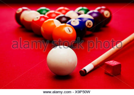 A Snooker Table In A Pub With Red Balls; Billards Pool Game. Cue Ball, Cue  Color Balls In Triangle, Chalk   Stock