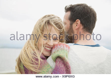 closeup of mid-adult couple hugging - Stock Photo