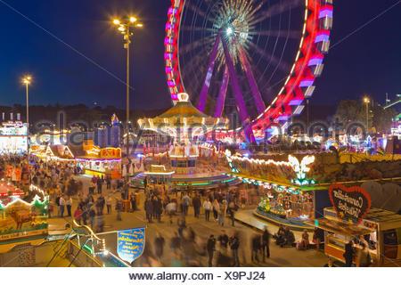 Fairground rides at the Cannstatter Volksfest or Cannstatter Wasen, also Stuttgart Beer Festival, Cannstatter Wasen - Stock Photo
