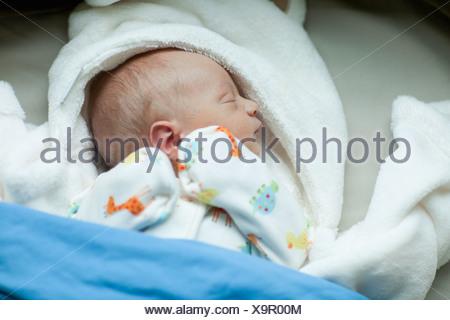 USA,Montana,Whitefish,Baby boy (0-1 months) sleeping - Stock Photo