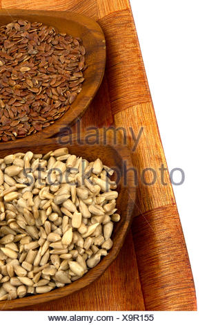 Flax and sunflower seeds on wooden  bowls - Stock Photo