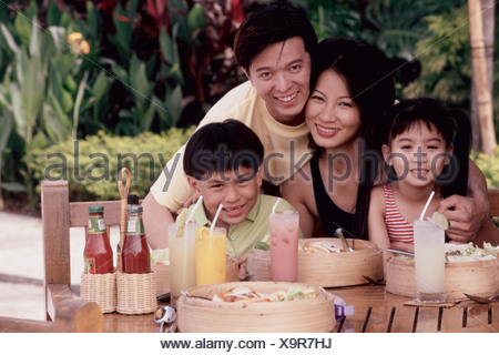 Portrait of parents with their son and daughter - Stock Photo