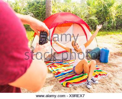 USA, Florida, Tequesta, Man taking photo of woman - Stock Photo