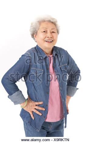 Studio Shot Of Chinese Senior Woman - Stock Photo