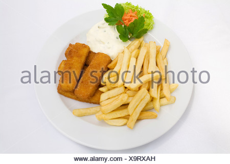 Fish sticks, tartar sauce and french fries served on a white plate - Stock Photo