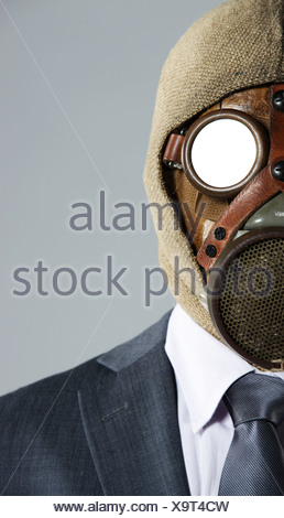 portrait of businessman in a gas mask - Stock Photo