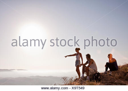 Spain, Alicante, Cocentaina, Tourists in mountains looking at view - Stock Photo