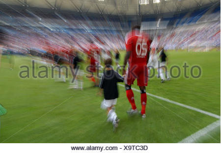 Teams walking on to the pitch, Liga total Cup 2010, League total Cup, match for third place between Hamburger SV and FC Koeln - Stock Photo