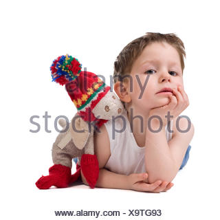Cute 3-4 years old boy with his best toy friend - Stock Photo