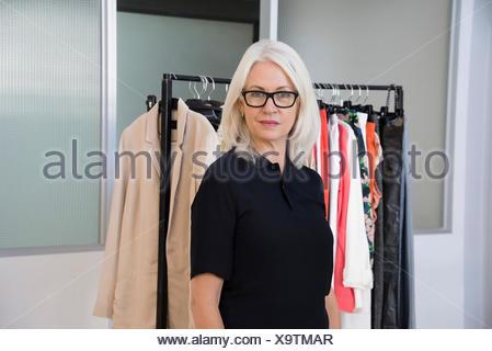 Dress designer standing in her office - Stock Photo
