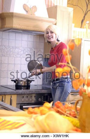 woman cooking in the kitchen - Stock Photo