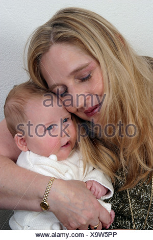 Grandmother hug grandchild, adore baby girl - Stock Photo