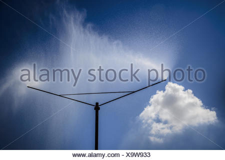 A sprinkler system sprayed a water curtain - Stock Photo