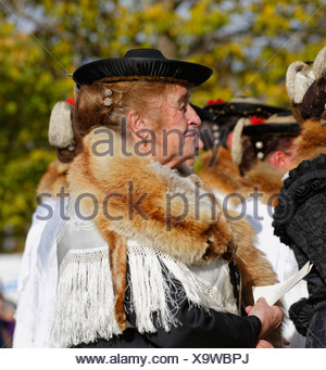 Woman wearing a fox stole during the Leonhardiritt procession, Wildsteig, Pfaffenwinkel region, Upper Bavaria, Bavaria, Germany - Stock Photo