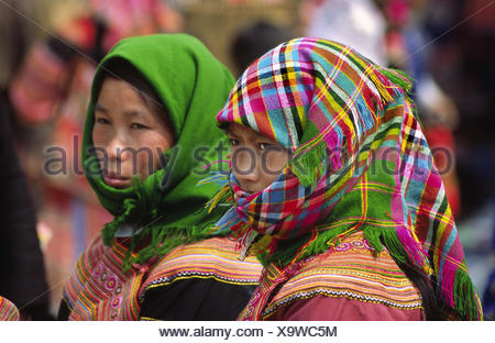 Flower Hmong minority women at Coc Ly Market, Lao Cai Province, Vietnam - Stock Photo