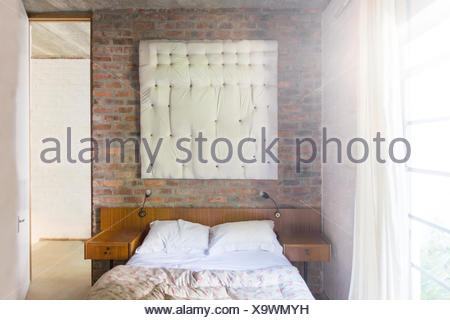 Wall hanging in modern bedroom - Stock Photo