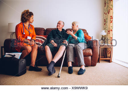 Elderly Couple with Home Carer - Stock Photo