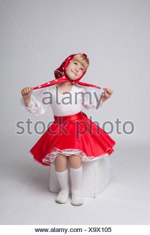 Sweet little ballerina posing in folk costume - Stock Photo