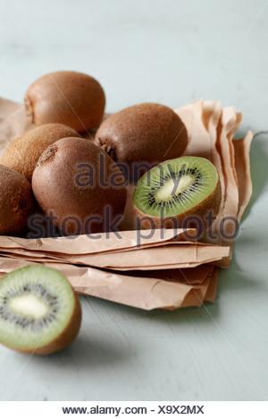 Pile of kiwis in paper - Stock Photo