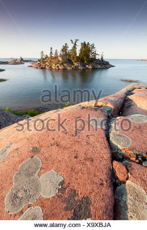 Pink granite islands in Georgian Bay on Lake Huron as seen the Chikanishing Trail in Killarney Provincial Park Ontario Canada - Stock Photo