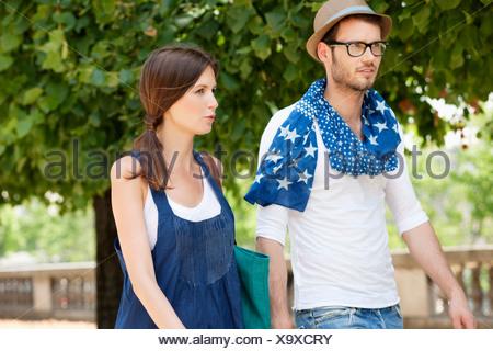 Couple walking together, Paris, Ile-de-France, France - Stock Photo