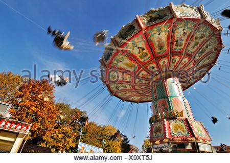 Chair-o-planes or swing carousel, Auer Dult fair, Munich, Bavaria - Stock Photo