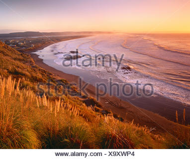 New Zealand. North Island, Port Waikato coast at sunset. - Stock Photo