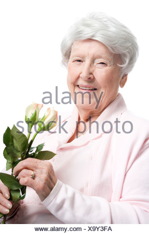 Portrait of an elderly woman smiling - Stock Photo