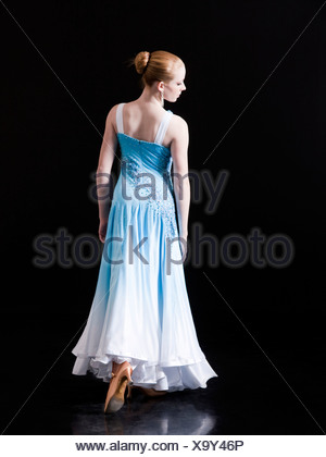 Young woman posing as professional dancer, studio shot - Stock Photo