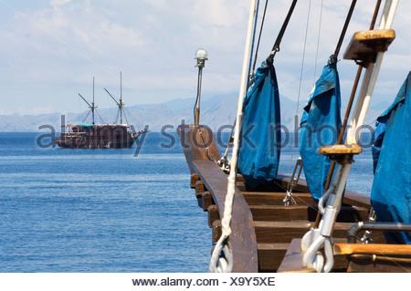 Traditional Indonesian two masted sailing ships, called Pinisi, at anchor. - Stock Photo