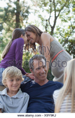 Family relaxing together outdoors - Stock Photo
