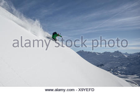 Austria, Freeride skier downhill skiing - Stock Photo