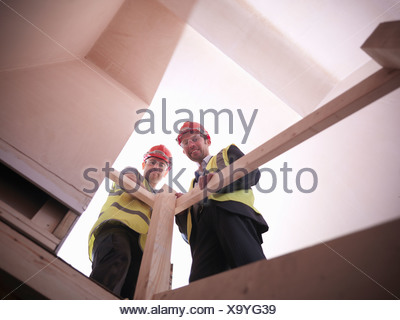 Builder and site manager in house - Stock Photo