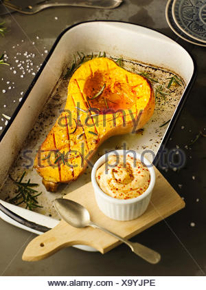 Butternut pumpkin from the oven with chili mayonnaise - Stock Photo