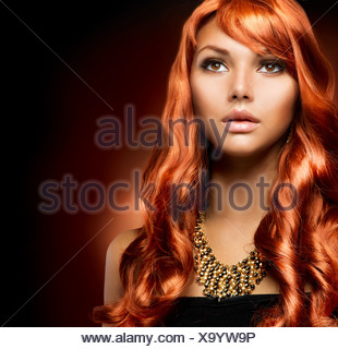 Portrait of a Beautiful Girl With Healthy Long Red Hair - Stock Photo