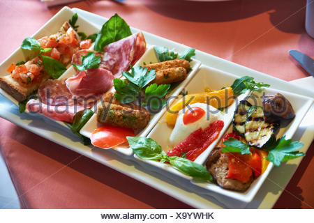 Selection Of Antipasti Served On Tray - Stock Photo