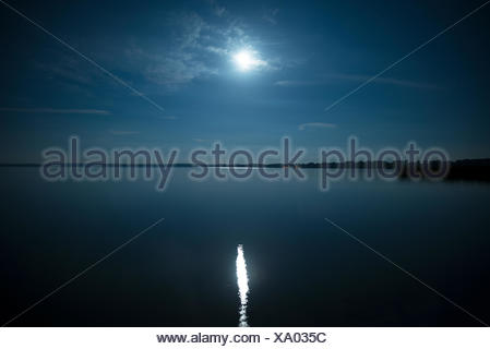 Full moon reflected in the water - Stock Photo