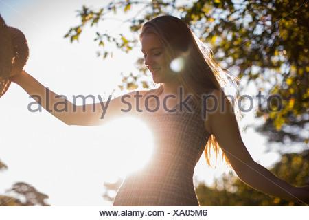 Teenage girl dancing in park - Stock Photo
