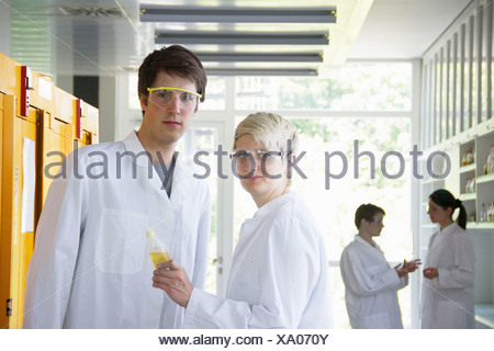 Chemistry students in laboratory, portrait - Stock Photo