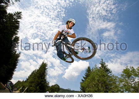 teenager jumping with a mountain bike, Austria - Stock Photo