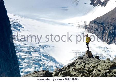 A hiker overlooks Bugaboo Glacier in Bugaboo Alpine Provincial Park, British Columbia - Stock Photo