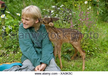 Boy deer lick