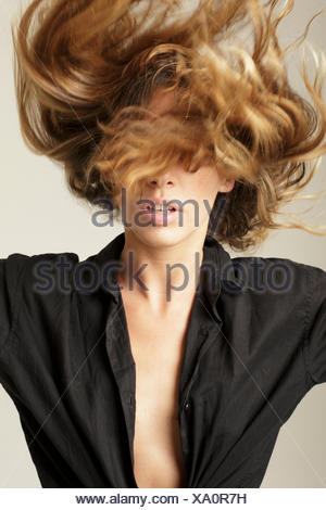 Woman flipping long blond hair - Stock Photo