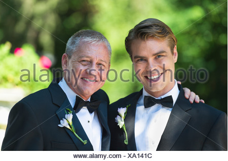 USA, New York State, Old Westbury, Portrait of father with bridegroom at wedding - Stock Photo