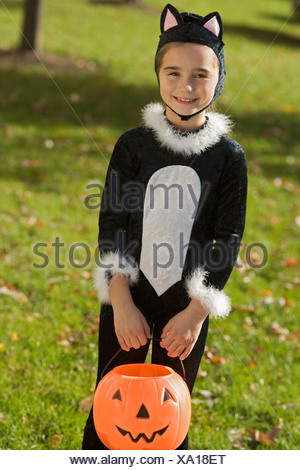 Portrait of girl in Halloween costume - Stock Photo