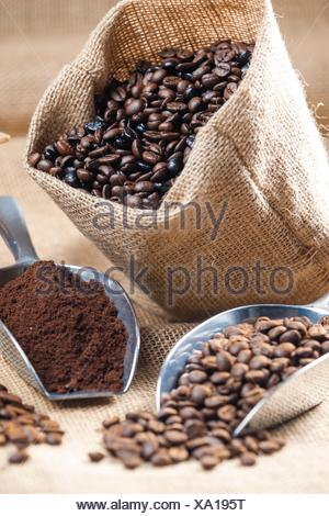 still life of coffee beans in jute bag. - Stock Photo